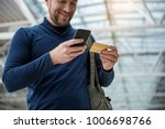low angle of pleased guy... | Shutterstock . vector #1006698766