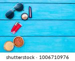 makeup products on blue wood... | Shutterstock . vector #1006710976