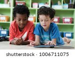 american and african boys are... | Shutterstock . vector #1006711075