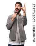 handsome man with beard singing ... | Shutterstock . vector #1006711528