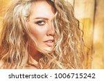 beautiful curly blonde portrait | Shutterstock . vector #1006715242