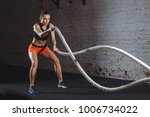 woman training with battle rope ... | Shutterstock . vector #1006734022