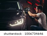 car polish wax. worker hands... | Shutterstock . vector #1006734646