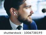 man with wireless earpiece   Shutterstock . vector #1006738195