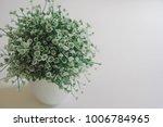 artificial flower in white vase | Shutterstock . vector #1006784965
