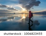 the girl is walking on the ice... | Shutterstock . vector #1006823455