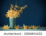 Daffodils In Vase On Blue...