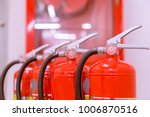 red tank of fire extinguisher... | Shutterstock . vector #1006870516