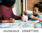 mom and son saving money to... | Shutterstock . vector #1006877602