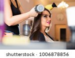 hairdresser dries hair with a... | Shutterstock . vector #1006878856