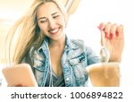young woman using smartphone at ... | Shutterstock . vector #1006894822