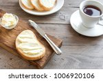 butter and bread for breakfast  ...   Shutterstock . vector #1006920106