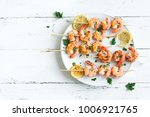 grilled shrimp skewers. seafood ... | Shutterstock . vector #1006921765