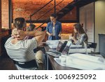 young hipsters in the loft | Shutterstock . vector #1006925092