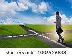 young businessman at crossroads ...   Shutterstock . vector #1006926838