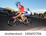 SCOTTSDALE, AZ - OCTOBER 2: Cyclists compete in the Scottsdale Cycling Festival Criterium, a high-speed circuit race on a 1-kilometer course for skilled cyclists in Scottsdale, AZ on October 2, 2010. - stock photo