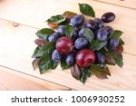 plums on table. wet fresh plums ... | Shutterstock . vector #1006930252