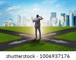 young businessman at crossroads ...   Shutterstock . vector #1006937176