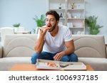 man eating pizza having a... | Shutterstock . vector #1006937185