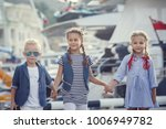 sisters and brother in a marine ... | Shutterstock . vector #1006949782
