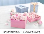 Gift Box With Flowers On Woode...