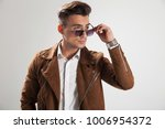 side view of a young casual man ... | Shutterstock . vector #1006954372