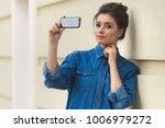 stylish beautiful woman in...   Shutterstock . vector #1006979272