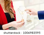 man buying a valentines gift in ... | Shutterstock . vector #1006983595