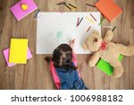 little asian girl drawing with... | Shutterstock . vector #1006988182