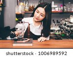 women barista making coffee on... | Shutterstock . vector #1006989592