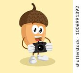 nut mascot and background with... | Shutterstock .eps vector #1006991392