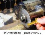 golden key in a locksmith hand... | Shutterstock . vector #1006995472