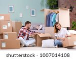 young couple packing wardrobe... | Shutterstock . vector #1007014108