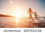 mother and daughter running... | Shutterstock . vector #1007023138