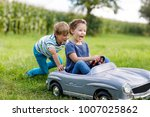 two happy children playing with ... | Shutterstock . vector #1007025862