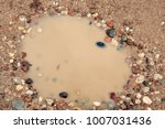 small stones around the puddle...   Shutterstock . vector #1007031436