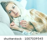 ill girl wrapping in blanket on ...   Shutterstock . vector #1007039545