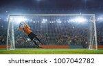 soccer goalkeeper in action on... | Shutterstock . vector #1007042782