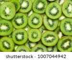Top View Of Sliced Kiwi As...