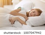cute girl sleeping on white... | Shutterstock . vector #1007047942