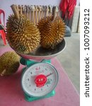 Small photo of Ipoh, Malaysia - January 22, 2018 : Durian is a smelliest fruits in the world and very famous in Malaysia, ready for sale by scaling on weight scale.