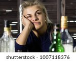 lonely woman drinks alcohol in... | Shutterstock . vector #1007118376