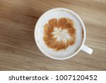 cup of hot coffee with latte... | Shutterstock . vector #1007120452