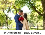 beautiful couple posing in park ... | Shutterstock . vector #1007129062