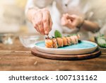 male chef cooking sushi rolls ... | Shutterstock . vector #1007131162
