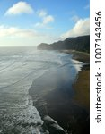 piha beach with rock formations ... | Shutterstock . vector #1007143456