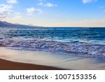 picturesque waves wash the... | Shutterstock . vector #1007153356