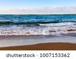 picturesque waves wash the... | Shutterstock . vector #1007153362