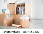 wardrobe boxes with clothes... | Shutterstock . vector #1007157532