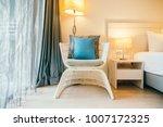 pillow on sofa chair decoration ... | Shutterstock . vector #1007172325